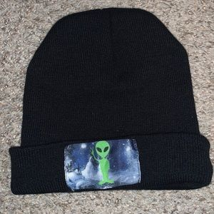 Alien throwing up peace sign beanie